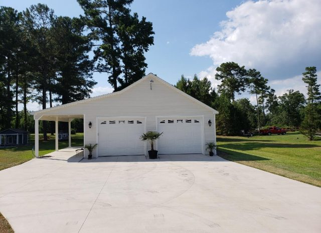 white double wide garage with 7 pitch roof