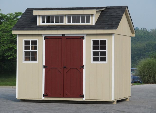 transom dormer shed with red doors
