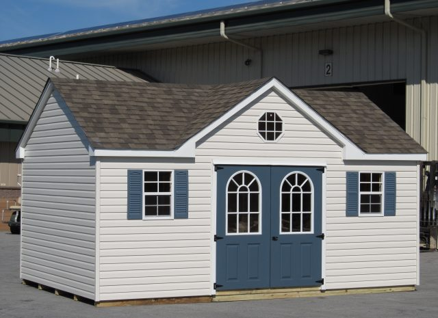 custom dormer shed with teal doors
