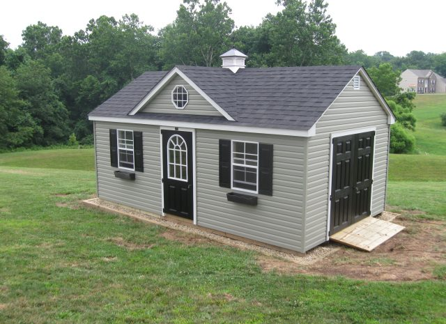 green cape code style dormer shed