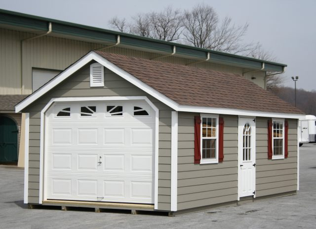 tan single car garage with brown roof