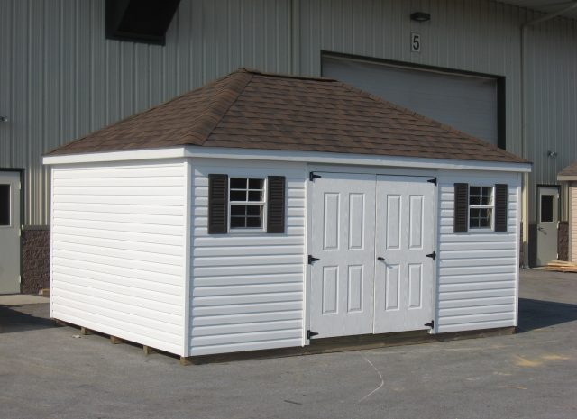 white hip roof storage shed with asphalt roof