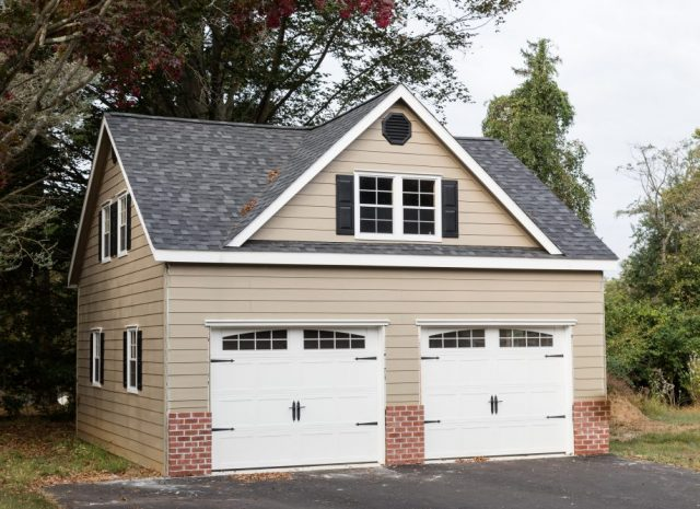 detached 2 story 2 car garage with brick inlay