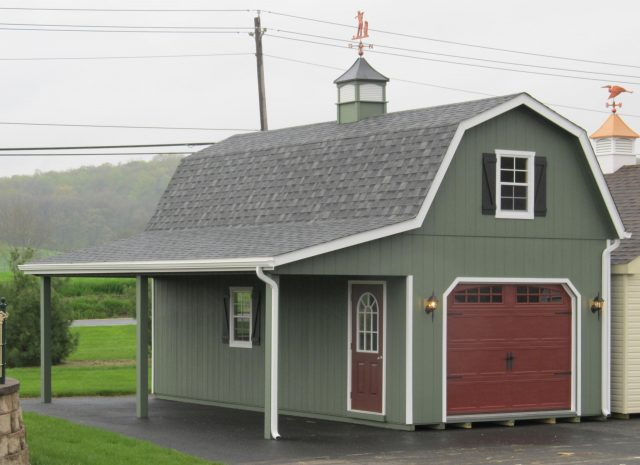 2 story gambrel garage with green siding