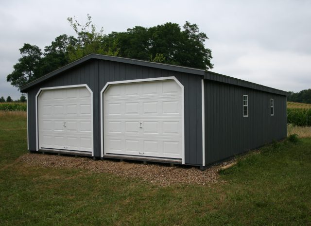 grey and white double wide 3 pitch roof garage