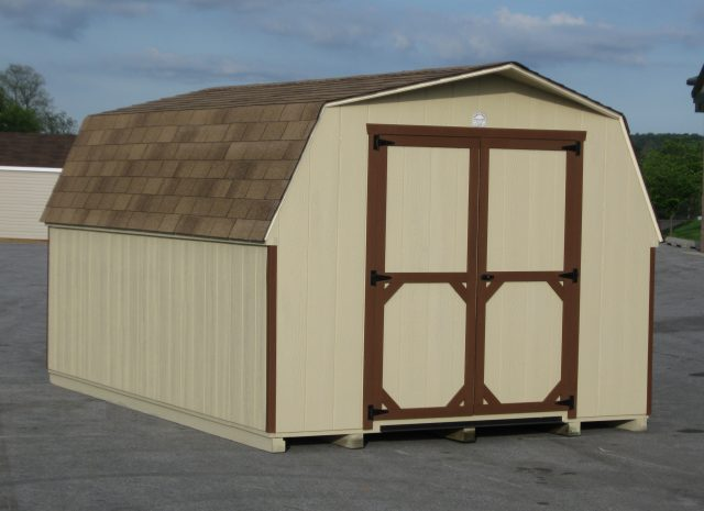 brown monochromatic mini barn shed in a pa parking lot