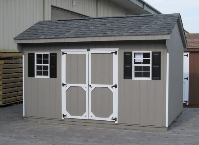 grey quaker style shed sitting in a sales lot