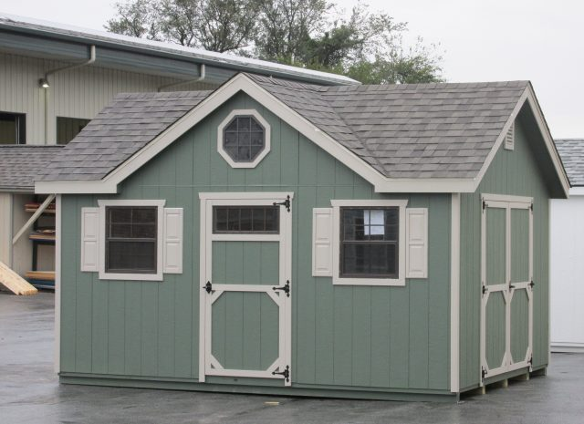 mint green dormer shed with dutch door