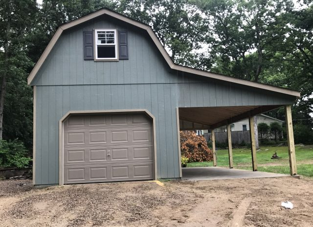 blue vinyl 2 story gambrel garage