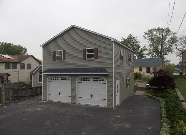 neutral detached double wide garage with 2 stories