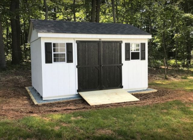white a frame shed with black accents