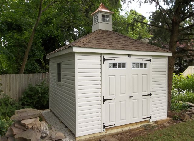 white hip roof garden storage shed