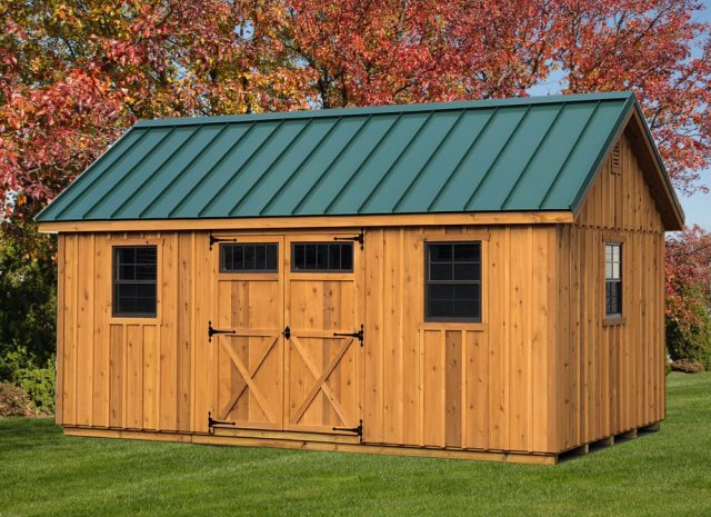 wooden garden shed with green roof