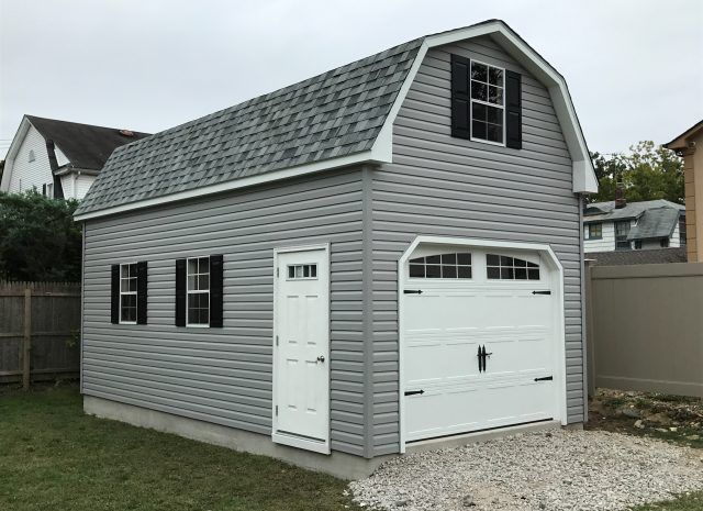 grey vinyl gambrel garage with loft